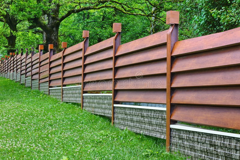 Modern Fence Made From Metal Siding Like As Natural Wood. Modern Fence Made From Metal Siding And Profile Sheet Like As Natural Wood Board royalty free stock images