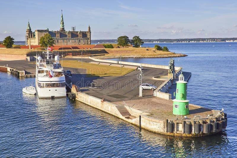 Modern ferry boat at pier, Kronborg castle at backgroung, Danmark, Europe. Modern ferry boat at pier, Kronborg castle at backgroung, Helsingor, Zealand, Danmark stock photography
