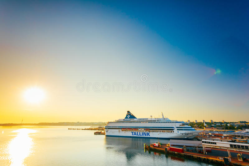 Modern Ferry At Pier. Early Morning With Beautiful. TALLINN, ESTONIA - JULY 26, 2014 Modern Ferry TALLINK At Pier Awaiting Loading Cargo From Port And Passenger stock photography