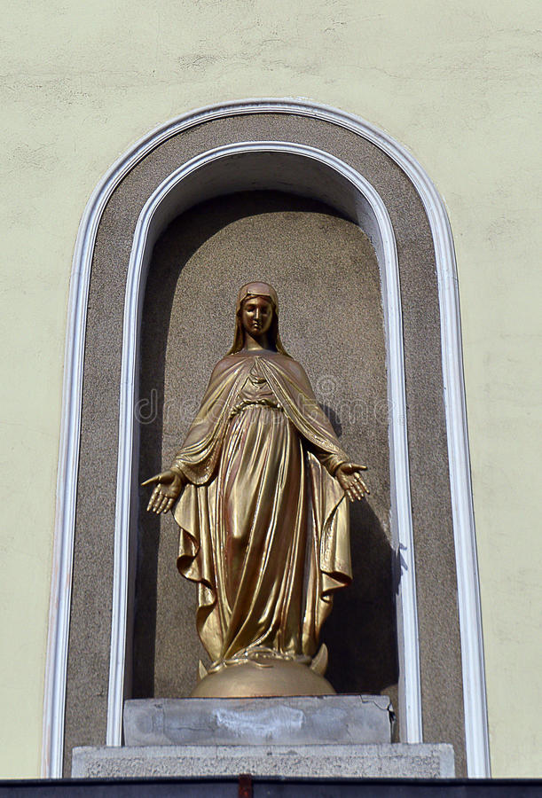 Modern figure of St Mary outside Roman Catholic church royalty free stock images