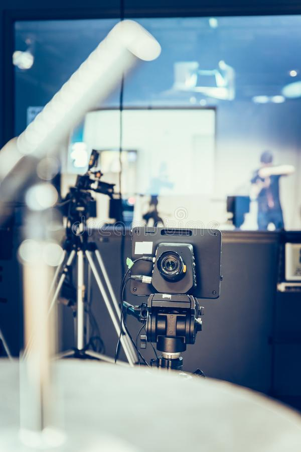 Modern film camera on a tripod in a broadcasting studio, spotlights and other equipment. Film camera on a tripod in a television broadcasting studio, spotlights stock photos
