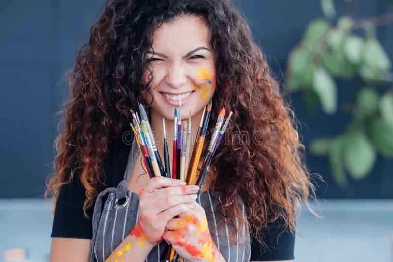 Modern fine art school lady bunch paintbrushes stock photo