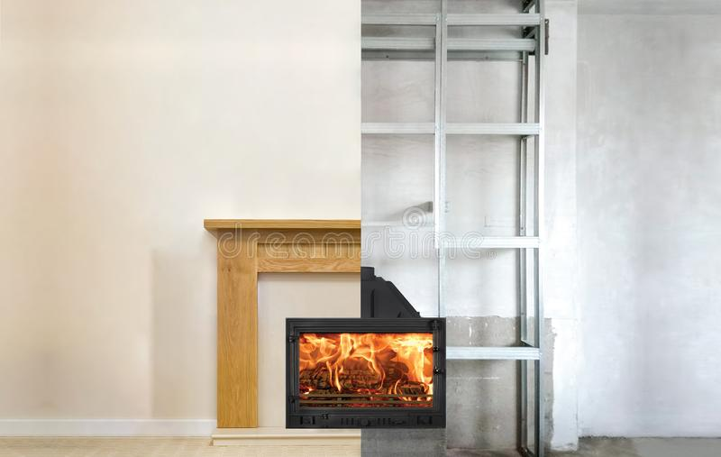 Modern fireplace in the apartment interior with real fire. Process installation royalty free stock image