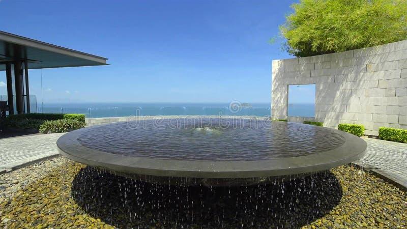 Modern fountain design in the garden stock images