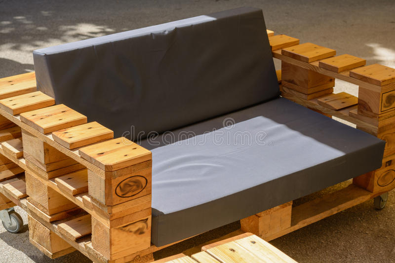 Modern furniture, made of wooden pallets - Upcycling. Modern rustic wood furniture from pallets - Upcycling stock photography