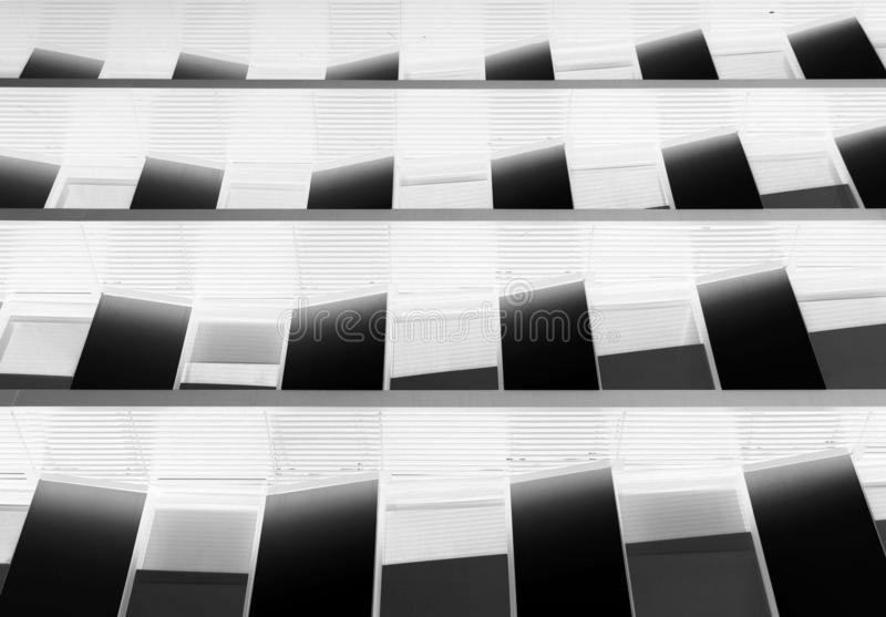 Modern futuristic abstract negative image architecture concept background with geometric angled windows royalty free stock photo