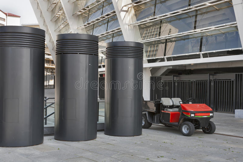 Modern futuristic city scene. With pipes and small red cart royalty free stock images