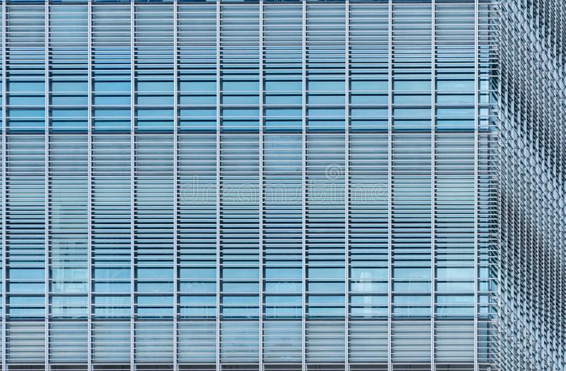 Modern futuristic glass building abstract background. Exterior of office glass building architecture. Facade of sustainable royalty free stock photos