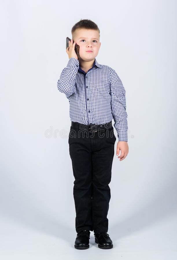 Modern gadget. Small businessman. Business school. Upbringing and development. Little boy formal clothes call mobile royalty free stock photo