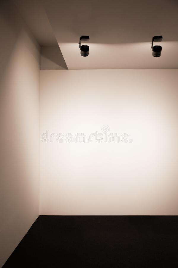 Modern gallery interior with empty frame on wall stock image