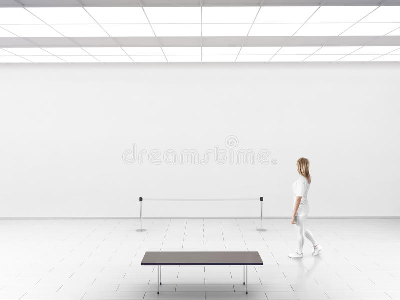 Modern gallery wall mockup. Woman walk in museum hall stock photos