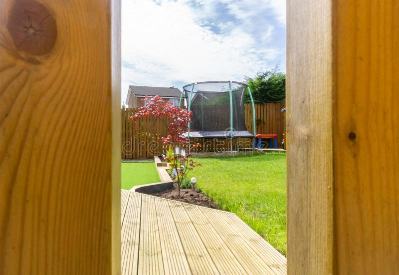 Modern garden with a new Planted Lawn from a Child`s Eye view. stock photography
