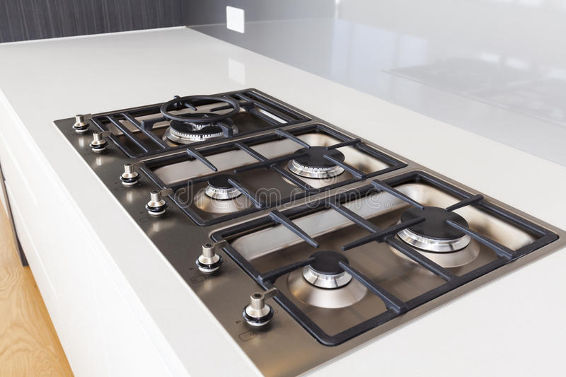 Modern gas cooktop. In new home stock photography