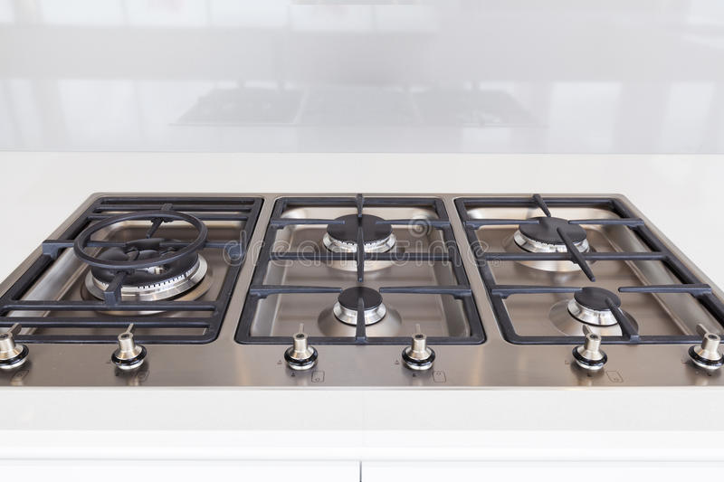 Modern gas cooktop. In new home royalty free stock images