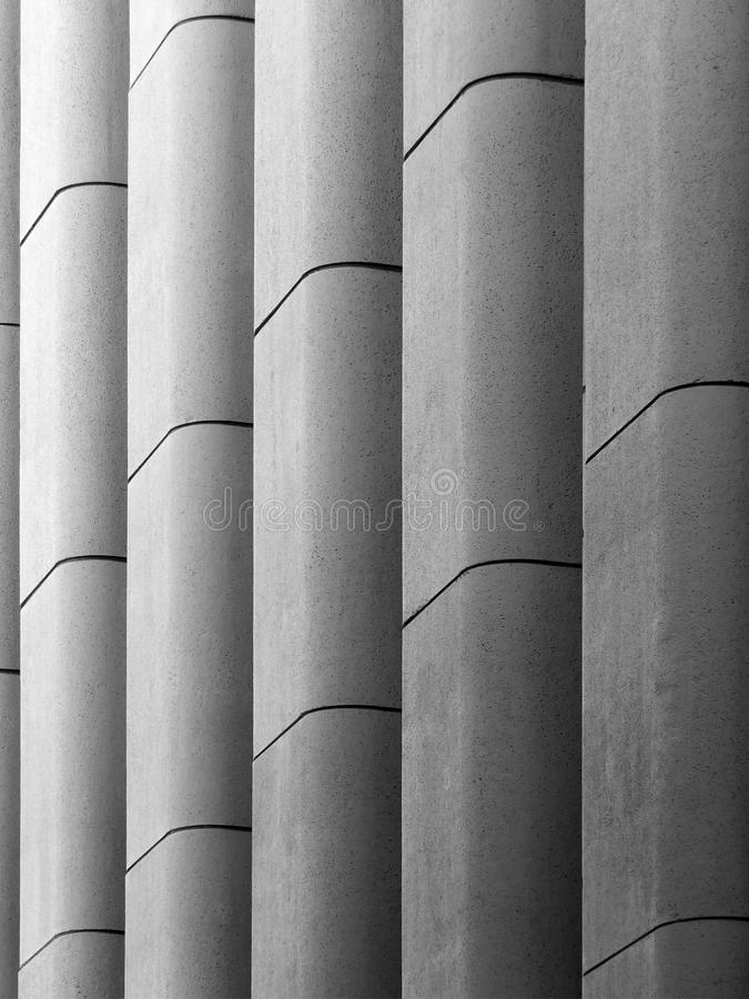 Modern geometric concrete. Modern concrete brutalist wall with vertical moulding patterned background stock photo