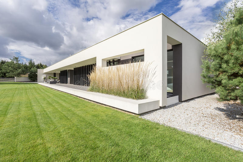 Modern geometric villa. Rectangualr block of minimalistic, modern and geometric villa royalty free stock image