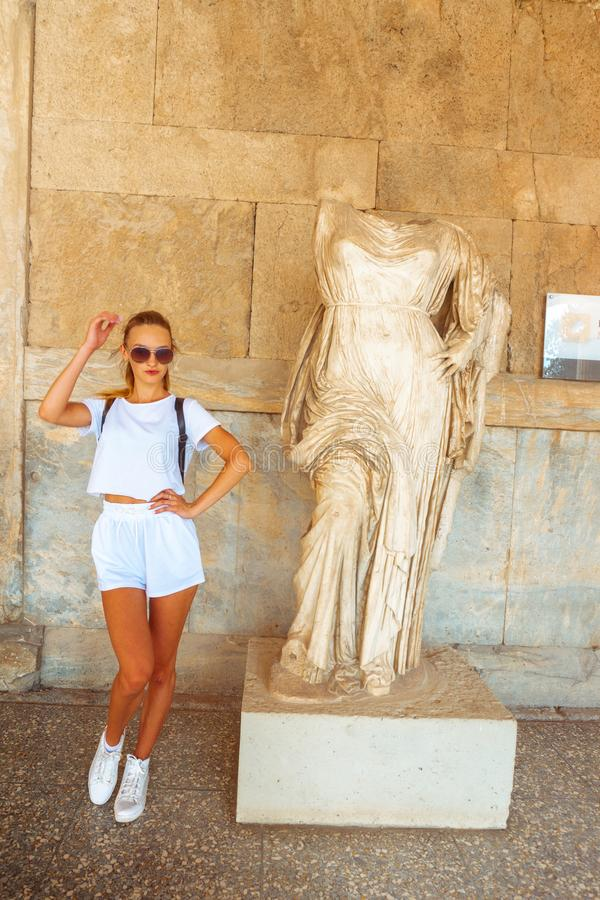 Modern girl and ancient Greek statue royalty free stock photos