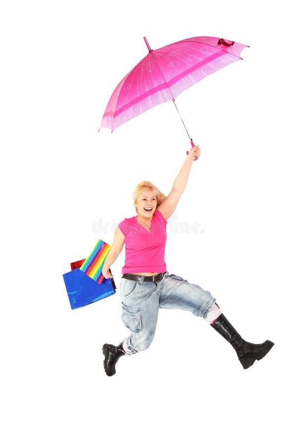 Modern girl with crimson umbrella royalty free stock photo