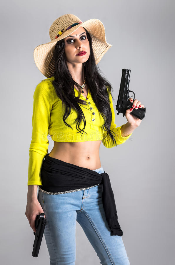 Modern girl with guns stock photos