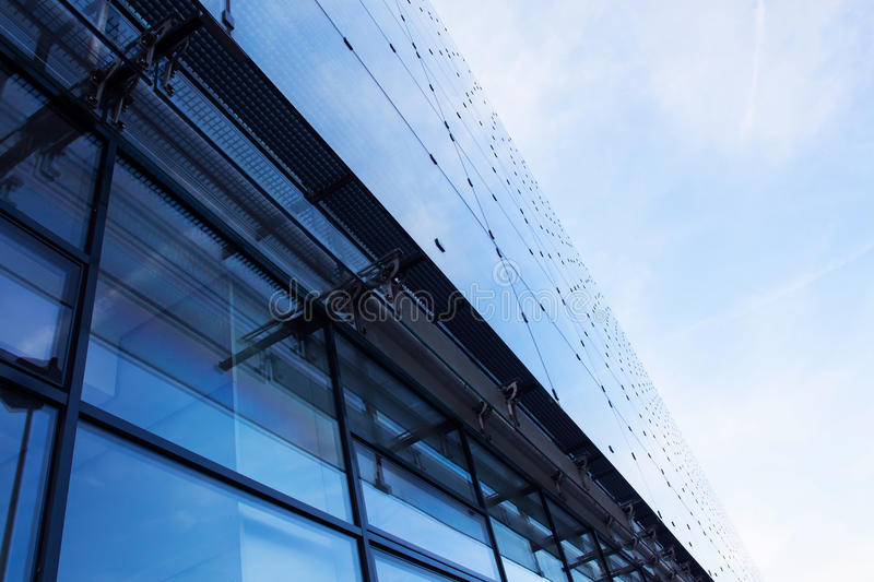 Modern Glass Architecture Against Sky Stock Photo