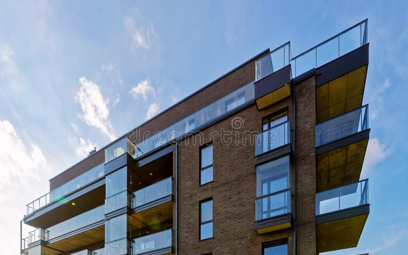 Modern glass architecture of apartment residential building reflex stock image