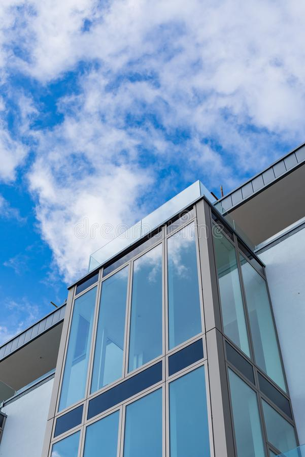 Modern glass architecture with blue sky royalty free stock images