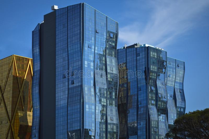 Modern glass building in the city center. Business center, institutional glass tower, Modern glass building, business center with blue sky royalty free stock photography