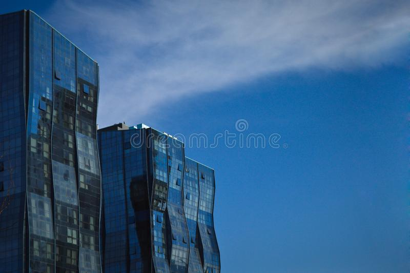 Modern glass building in the city center. Business center, institutional glass tower, Modern glass building, business center with blue sky stock images