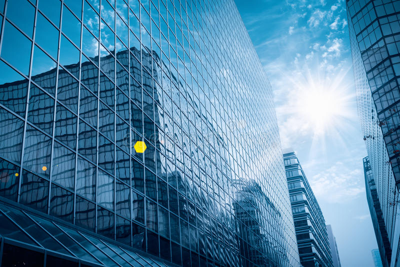 Modern glass building under the blue sky stock photos