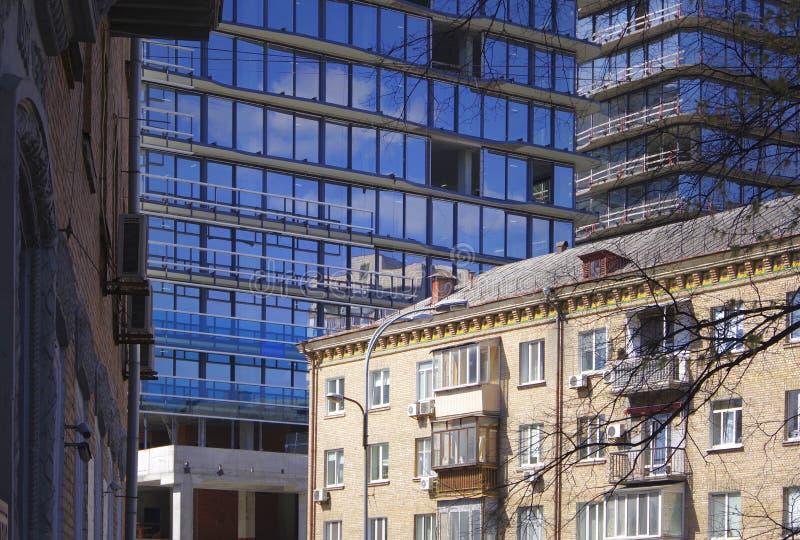 Kiev. Ukraine. Modern glass buildings next to old brick houses. Kiev. Ukraine royalty free stock photos