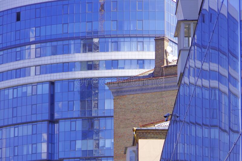 Kiev. Ukraine. Modern glass buildings next to old brick houses. Kiev. Ukraine stock image