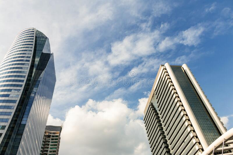 Modern glass buildings office, Skyscraper with blue sky and cloudy stock images