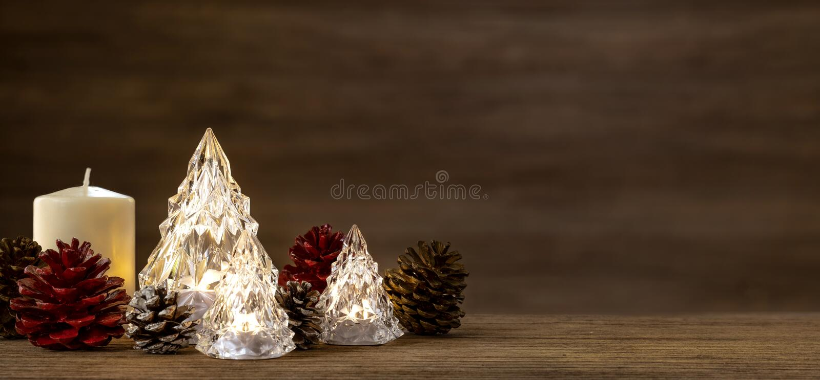 Modern glass Christmas tree with lights on dark wood table with wall for merry chirstmas and new year holiday greeting card royalty free stock photos