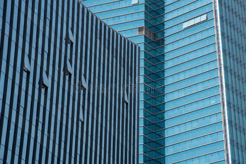 Modern glass skyscraper building with open windows royalty free stock image