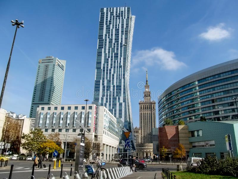 Modern glass tower Zlota 44 on the background of Warsaw cityscape. Skyscrapers: Hotel royalty free stock photo