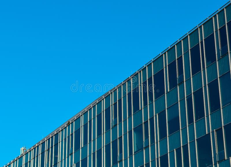 Modern glassy office building with blue sky. royalty free stock photos