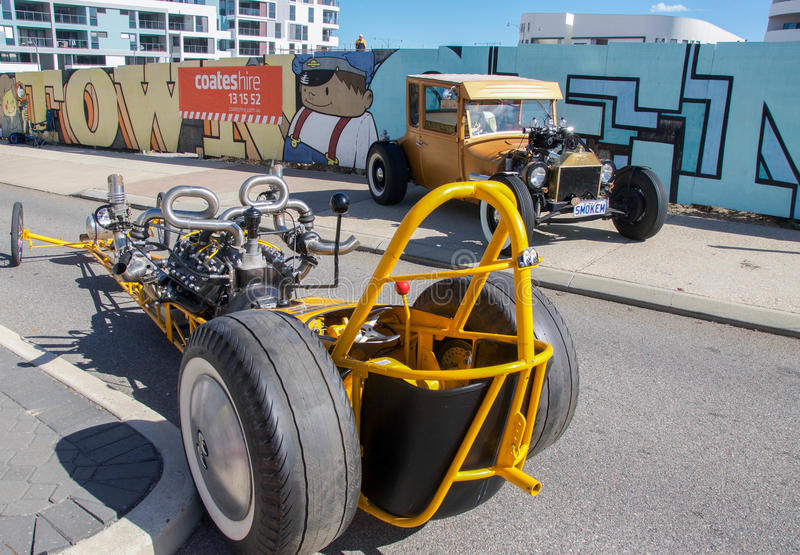 Modern Go Cart and Antique Car. COCKBURN CENTRAL,WA,AUSTRALIA-MARCH 13,2016: Go kart and golden antique car on display at the Cockburn Central Billy Cart royalty free stock image
