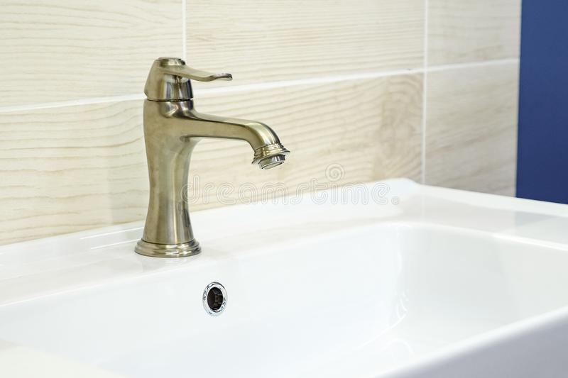 Modern gold wash tap faucet royalty free stock photography