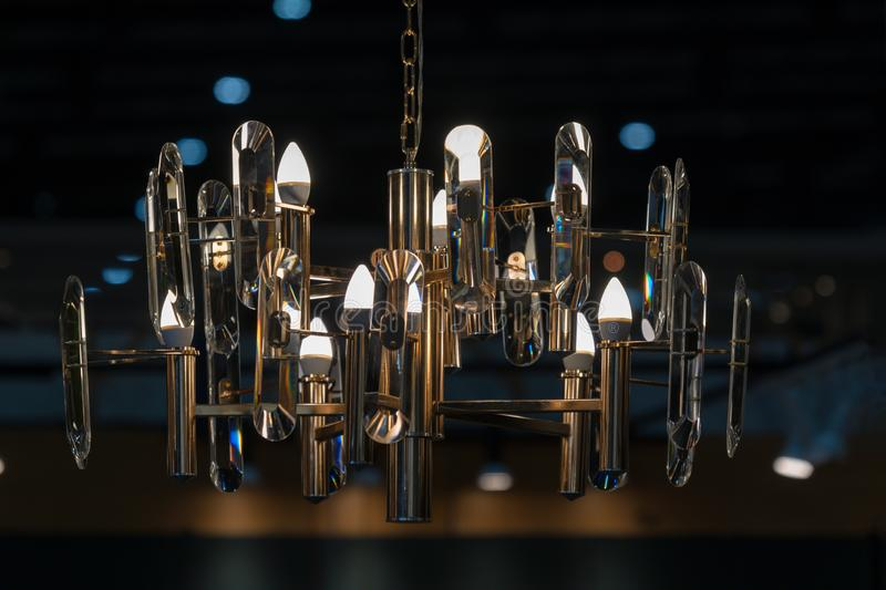 Modern golden chandelier in the light bulbs hanging from the ceiling luxury retro style interior stock images