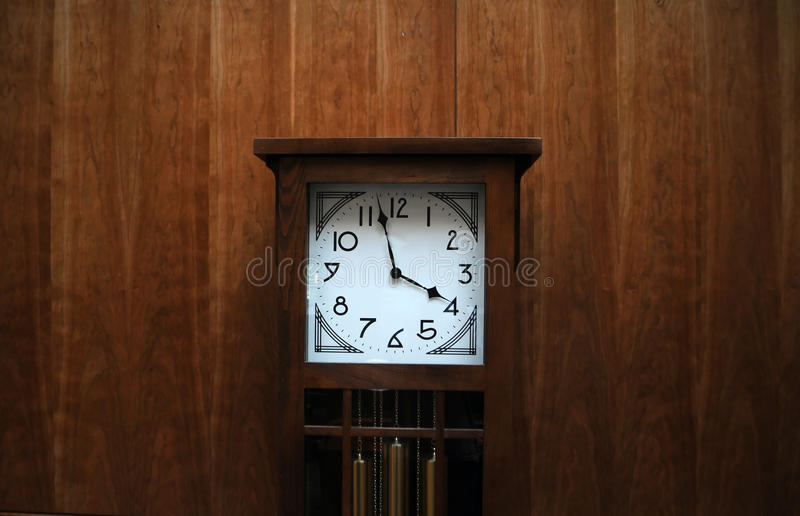 download modern grandfather clock against wooden wall stock photo image