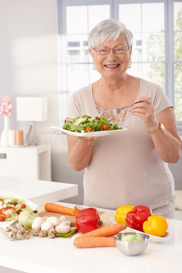 Modern grandmother eating healthy stock photography
