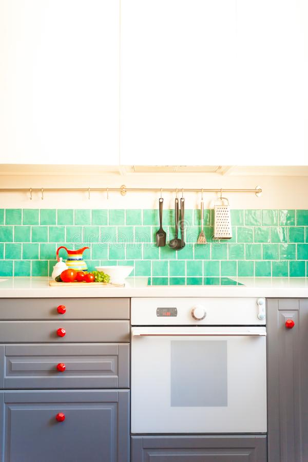 Download Kitchen Features Dark Gray Flat Front Cabinets Paired With White Quartz  Countertops And A Glossy