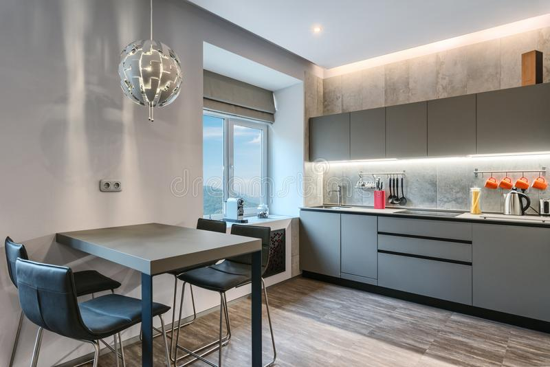 Modern gray kitchen interior stock images