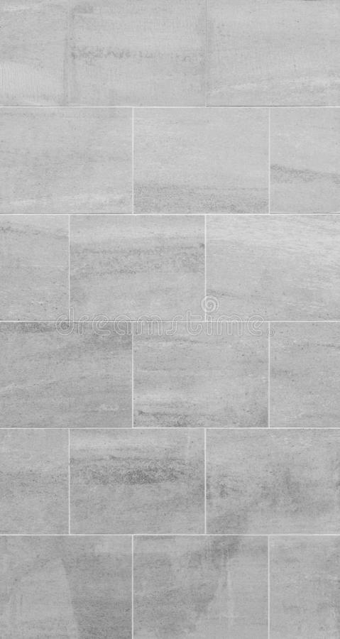 Modern gray slab wall background. Full frame background of a new, modern and clean wall or building exterior made of slabs in black and white royalty free stock images
