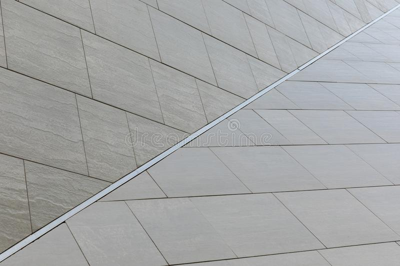 Modern gray tiled roof of unusual shape, architecture design background. Modern gray tiled roof of unusual shape, architecture design background stock images