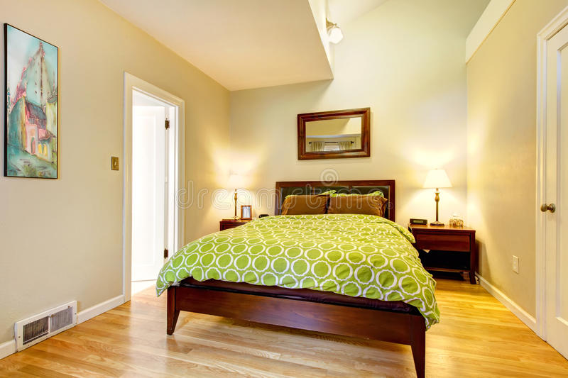 Modern Green And Beige Bedroom With Brown Bed. Royalty
