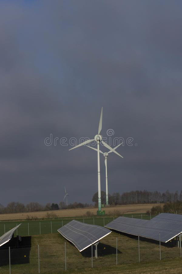 Modern green city powered only by renewable energy sources concept.  stock photos