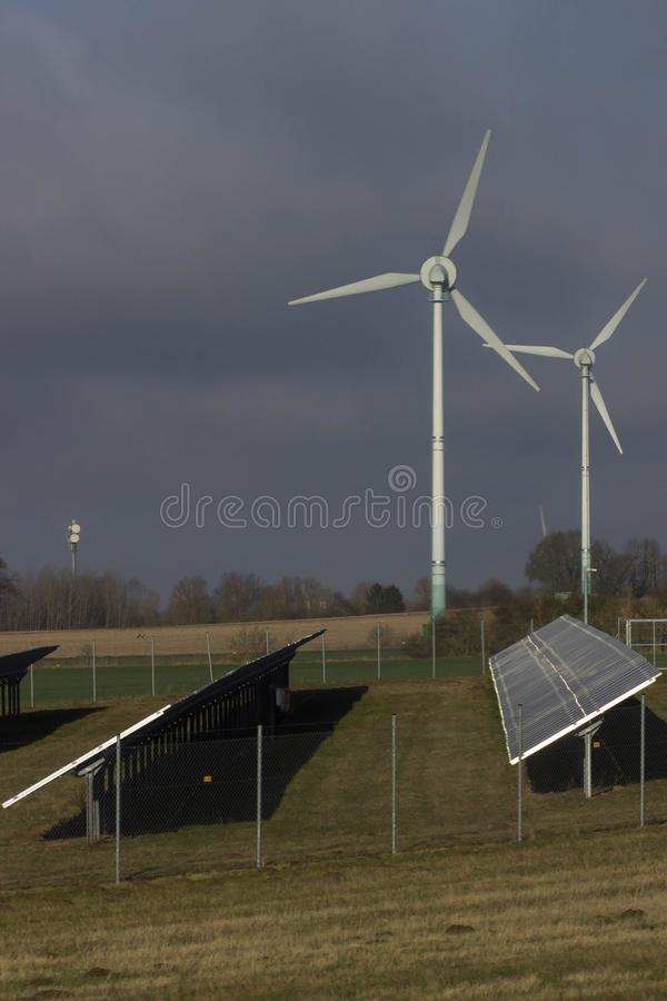 Modern green city powered only by renewable energy sources concept.  stock photo