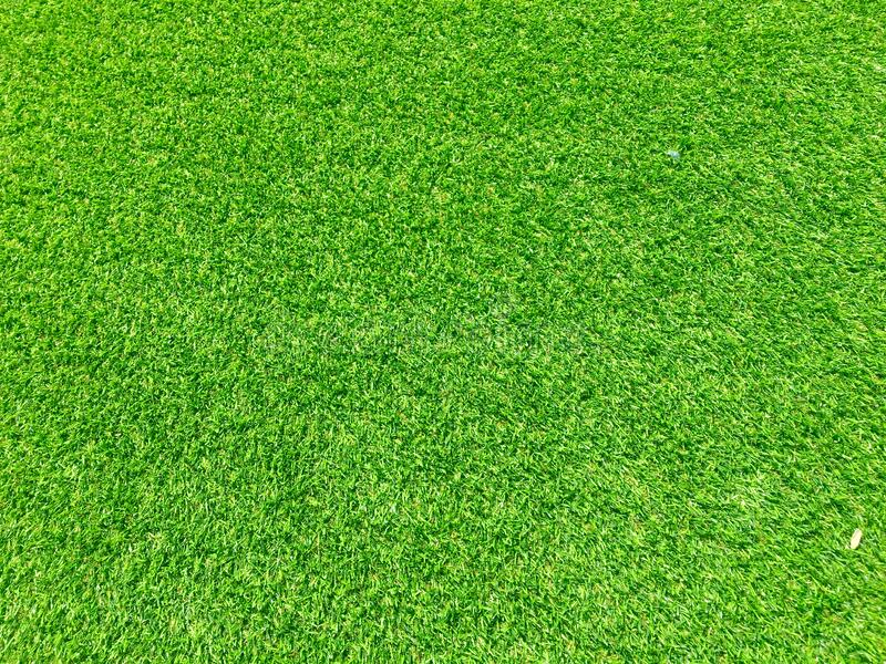 Modern green lawn texture background. Wallpaper for work and design royalty free stock photos