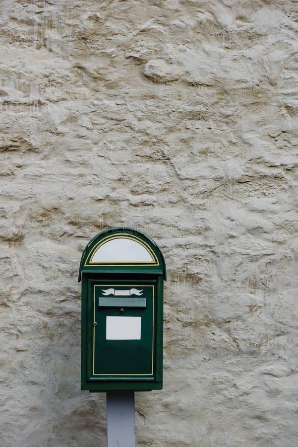 Modern green postbox stock photo